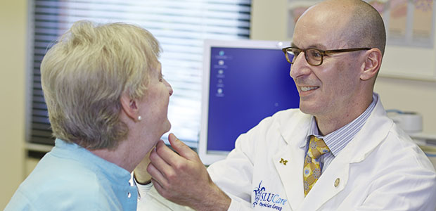 Pictured: SLUCare facial cosmetic surgeon Dr. Michael Bernstein with a skin cancer patient