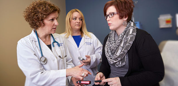 Pictured: Nurse practitioner Dana Hellebusch, registered dietician Shannon Breggeman and patient Kelly Rosemann