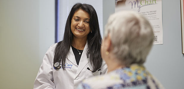 Pictured: SLUCare endocrinologist Dr. Gupta with a patient.