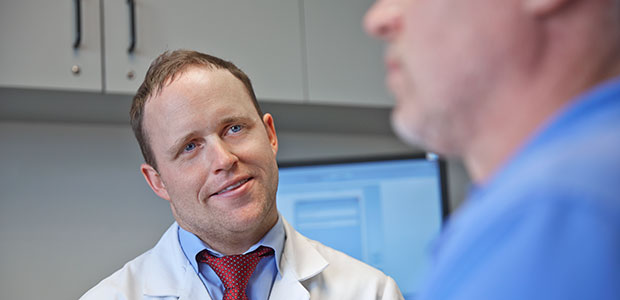 Pictured: Dr. Scott Walen consults with a patient
