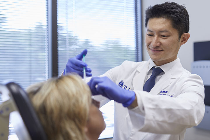 Dr. Collin Chen administers facial cosmetic injection to patient