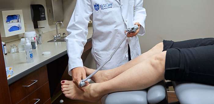 SLUCare vascular surgeon evaluates a patient in the Swelling Clinic