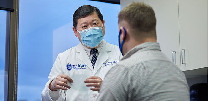 Dr. Scott Wong Discusses Surgery with a Patient